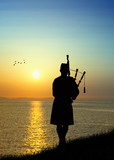 man plays the bagpipes