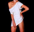 Slim woman in white t-shirt. Black background, copyspace
