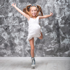 Cute little girl jump