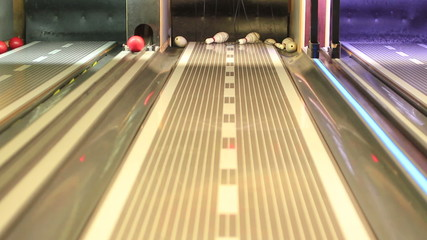 Young guys playing bowling