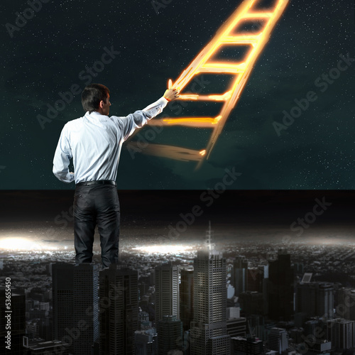 Businessman drawing ladder