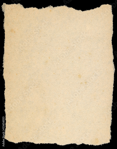 Vintage yellow torn paper isolated on black.