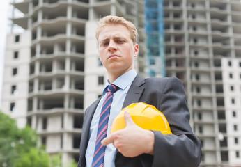 engineer holding a helmet