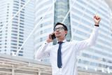 Asian business man speaking mobile phone