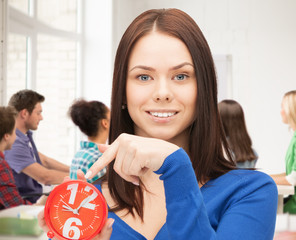girl holding big clock at school