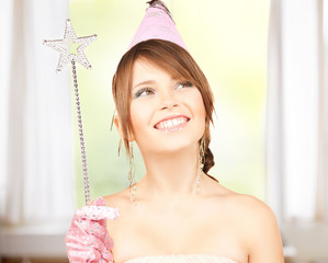 girl in party cap with magic wand