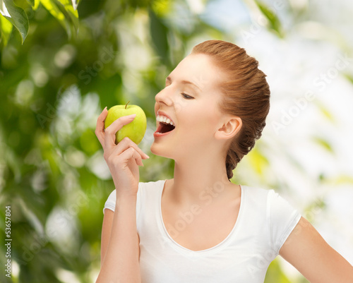 woman with green apple at countryside