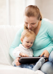 mother and adorable baby with tablet pc