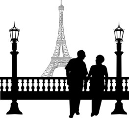 Lovely retired elderly couple walking in front of Eiffel tower