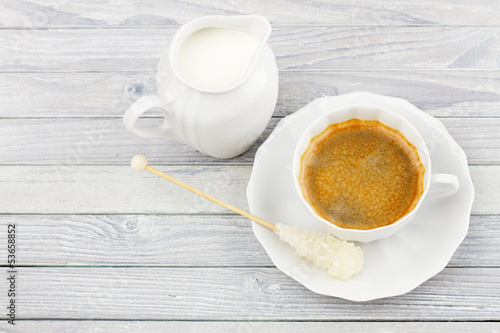 coffee and milk jug on a wooden table