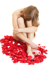portrait of a naked woman with red rose petals