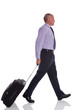 Businessman walking with travel suitcase.