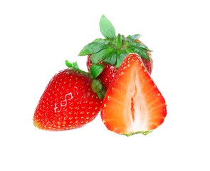 Strawberries with leaves, isolated on a white background.