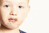 portrait of child. kid boy with chocolate dirty face