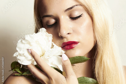 beautiful blond woman with white flower