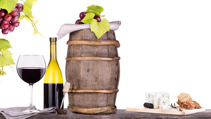 grapes on a barrel with corkscrew and wine glass