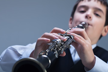 Boy playing on the clarinet