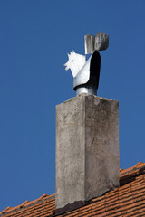 Chimney with metal cock on the mediterranean house in Croatia