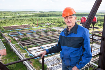 Smiling worker standing for high altitude platform. Copyspace