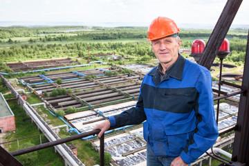 Smiling worker standing for high altitude platform. Copyspace