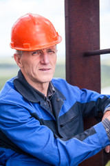 Portrait of elderly Caucasian man working in construction helmet
