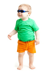 portrait of funny kid wearing sunglasses against a white backgro