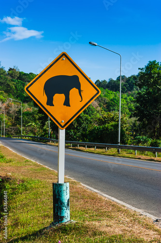 "Road sign ""caution elephants"" on the track"