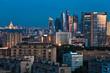late summer blue twilight over city