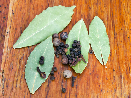 bay leaves and black pepper seeds
