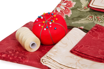 Quilting fabrics with thread and pin cushion
