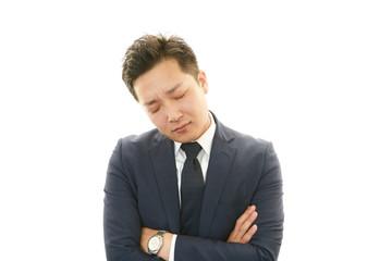 疲れた様子のビジネスマン