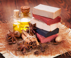 Handmade soap, oil in bottles anise and cinnamon on the table