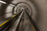 Moving fast through a modern, conrete tunnel