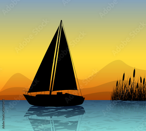 Sailing boat silhouette on a lake
