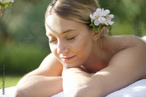 A young woman laying on a massage table