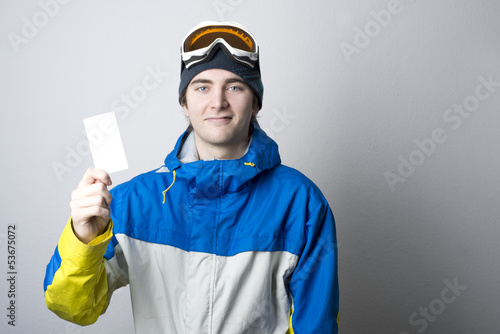 Lift pass with winter sports enthusiast