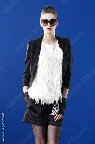 fashion woman wearing sunglasses against blue background