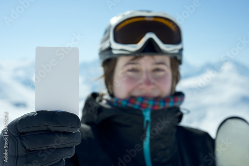 Young woman holding business card