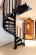 Spiral staircase and a wardrobe