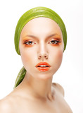 Art. Woman in Green Headwear and Trendy Professional Make-up