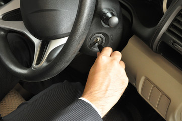 Businessman hand starting the car