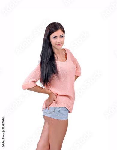 Улыбающаяся девочка в розовой кофте и юбке; фото