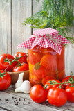 Homemade tomatoes preserves in glass jar. Fresh and canned tomat