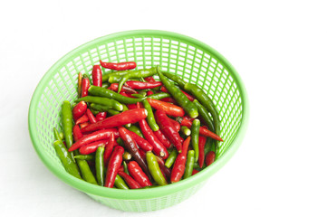 Red and green hot pepper in the basket