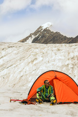 Climber prepares equipment for ascension on top