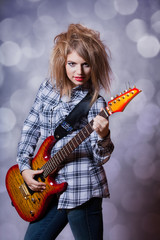 Fashion girl with guitar