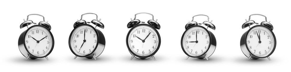 row of alarm clocks on white background