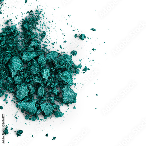 Crushed green eye shadow on white background