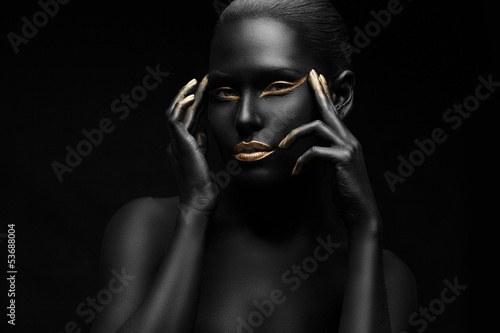 beautiful black girl with golden make-up