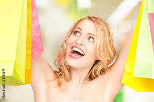 woman holding color shopping bags in mall